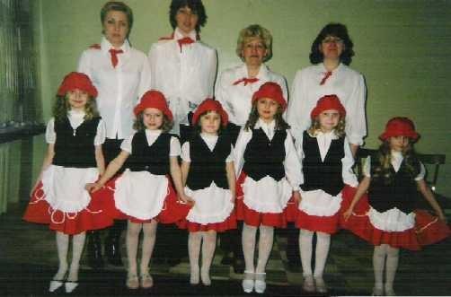 Во время исполнения песни детского сада.